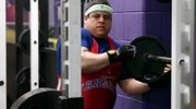 Brady Tanner, 29, puts more weight on the bar during his workout last week at Haskell University. Tanner has been active in sports of all kinds for most of his life. He is also a member of the Douglas County Special Olympics basketball team. Tanner has been chosen to compete in weightlifting events at the Special Olympics World Games in Greece.