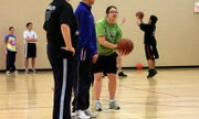 Becky Saathoff prepares to take her shot to the basket during a practice session before the Special Olympics basketball team headed to Hays for the state tournament.