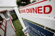 A foreclosed house is shown Feb. 19 in East Palo Alto, Calif. After months of criticism that it hasn't done enough to prevent foreclosures, the Obama administration is announcing a plan to reduce the amount some troubled borrowers owe on their home loans.