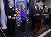 President Barack Obama, accompanied by, from left, Joint Chiefs Chairman Adm. Michael Mullen, Secretary of State Hillary Rodham Clinton and Defense Secretary Robert Gates, makes a statement on the new nuclear arms reduction treaty between the U.S. and Russia. Obama spoke Friday in the press briefing room of the White House.