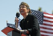 "Sarah Palin speaks Saturday at the ""Showdown in Searchlight"" tea party rally in Searchlight, Nev."