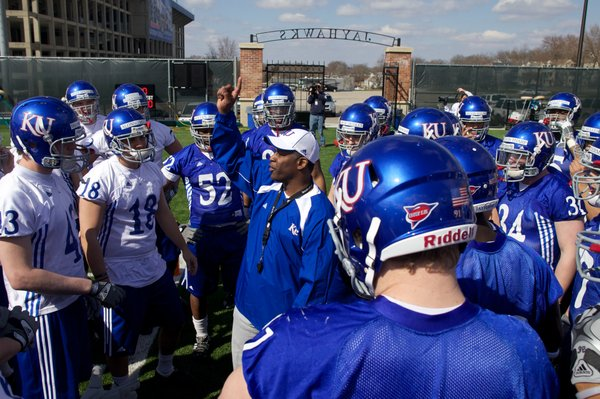 Kansas head coach Turner Gill gathers with the team during spring practice on Sunday, March 28, 2010.