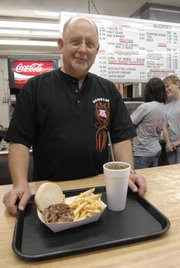 Jim Biemick, owner of Biemer's BBQ, 2120 W. Ninth St., is pictured with birthday freebies.