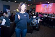KC Speed Dating staffer Janelle McKinney with the gong she uses to signal the end of a seven-minute date.