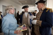 Eileen Roddy, left, chats with Dewey Fry right, and Richard Cox following the ceremony for Naturalization for new citizens at the U.S. District Court Mar. 26, 2010 in Kansas City, Kan. Both men are members of the Sons of the American Revolution from the Delaware Crossing Chapter.