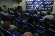 Kansas center Cole Aldrich sits along side head coach Bill Self as the two talk with media members about Aldrich's intention to enter the NBA draft Monday, March 29, 2010 at Allen Fieldhouse.