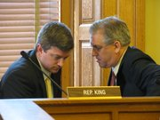State Rep. Jeff King, R-Independence, (left) and state Rep. Clark Shultz, R-Lindsborg, confer Tuesday during a meeting of a select committee investigating a complaint against House Speaker Mike O'Neal, R-Hutchinson. King read aloud the committee report that dismissed the complaint but said changes are needed to the law that allowed O'Neal to file a lawsuit against the state.