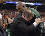 "Michigan State coach Tom Izzo, left, is congratulated by former Michigan State player Earvin ""Magic"" Johnson after the Spartans defeated Tennessee on Sunday in St. Louis to advance to the Final Four."