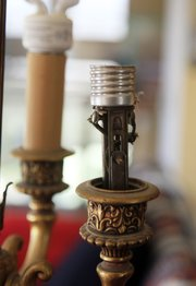 When it comes to old light fixtures, repairing rather than replacing is always a good option.