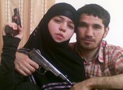 This undated picture provided Friday by the Russian news agency NewsTeam shows, according to the Russian newspaper Kommersant, Dzhennet Abdurakhmanova, left, and her husband, Umalat Magomedov. Kommersant said Friday that one of the Moscow subway suicide bombers was Abdurakhmanova, the 17-year-old widow of Magomedov, an Islamist rebel from the North Caucasus killed by Russian government forces in December 2009.