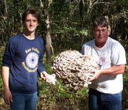Stan Schneck (right) with Bob Bruce, each holding a Hen of the Woods found in October, 2008.
