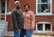 Will and Roxanne Ward, pictured in this March 13 photo in St. Louis, have entered a national competition to conserve household energy. The Ward family in the city's Oak Hill neighborhood will strive to cut energy consumption for three months. The Wards' home was built in 1911.