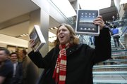 Andres Schobel holds up two iPads as one of the first customers to buy an iPad on the first day of Apple iPad sales Saturday at an Apple Store in San Francisco. Eager customers have been lining up outside Apple Stores and some Best Buys to be among the first to buy one as sales started at 9 a.m. Saturday in each time zone.