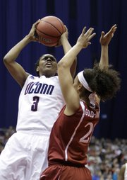Connecticut's Tiffany Hayes, left, shoots over Stanford's Rosalyn Gold-Onwude. UConn defeated Stanford, 53-47, for the NCAA women's title on Tuesday night in San Antonio.