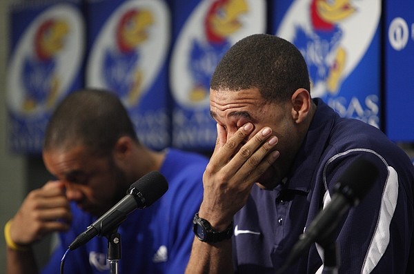 Kansas guard Xavier Henry has an emotional moment alongside his brother C.J. Henry, left, during a press conference in which Xavier declared his intention to enter the NBA draft, Wednesday, April 7, 2010 at Allen Fieldhouse.