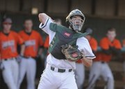 Free State catcher Adam Petz throws out a Shawnee Mission Northwest runner at first base during the seventh inning Thursday.