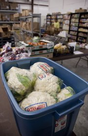 Fresh produce awaits visitors to Just Food of ECKAN, 1200 E. 11th  St. There will be a mobile food distribution on Monday, July 12, beginning at 10 a.m. The food will be delivered by Harvesters Community Food Network. Douglas County residents are encouraged to wait until 10 a.m. to pick up food — not earlier — because parking space is limited.