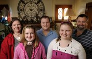 The Miller family, from left, Charity, Darby, Matthew, Afton and Kevin at their Salina home, discovered late last year that Darby had cancer. For nearly eight years, Charity and Kevin Miller had fulfilled the requests of seriously ill children, some of whom have had only months to live.