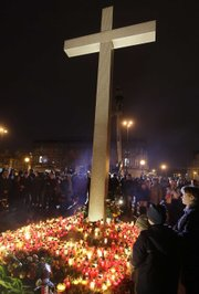 People place candles in the Pilsucki Square in Warsaw, Poland, on Saturday after Polish President Lech Kaczynski died in a plane crash.