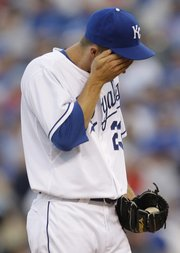 Kansas City Royals starting pitcher Zack Greinke wipes his face after giving up back-to-back home runs to the Boston Red Sox during the fifth inning. The Royals lost, 8-3, on Saturday in Kansas City, Mo.