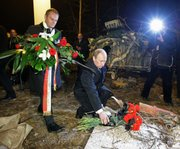 Russian Prime Minister Vladimir Putin, right, and Poland's Prime Minister Donald Tusk, left, lay flowers Saturday on the site of a plane crash near Smolensk, western Russia. Polish President Lech Kaczynski, his wife and some of the country's most prominent military and civilian leaders died Saturday along with dozens of others when the presidential plane crashed as it came in for a landing in thick fog  near Smolensk in western Russia.