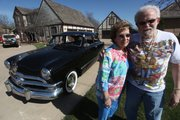 Joan and Ralph Thrash, pictured in this March 31 photo in Hutchinson, have restored their 1950 Ford. Ralph bought the car when he was 15 and dating Joan in 1953.