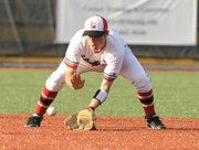 Lawrence High short-stop Landon Moseley (1) pulls up a ground ball for an easy out. LHS hosted the Olathe South Falcons on Monday April 12, 2010.
