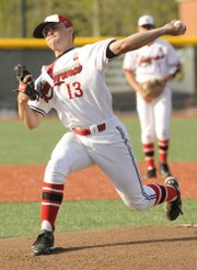 Lawrence High pitcher Albert Minnis (13) works hard in the third inning against the Olathe South Falcons. LHS hosted the Olathe South Falcons on Monday April 12, 2010.
