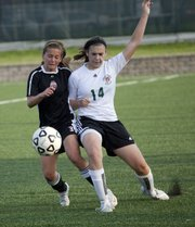 Lawrence Lions Elizabeth Burney, (3) left, and Free State's Kylee Loneker,(14) work for position and the ball during a soccer game at Free State Tuesday, April 13, 2010.