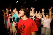 """LHS senior Lucas Parker sings during a rehearsal for """"Showtime."""" The director is LHS teacher Cathy Crispino."""