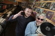 """Record Store Days: From Vinyl to Digital and Back Again"" co-authors Phil Gallo, left, and Gary Calamar visit Freakbeat Records in Los Angeles."