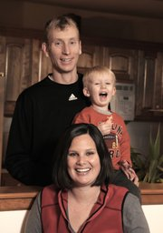 Sara Griffith is shown with her husband, Lance, and son, Julian, 2, in their Lawrence home.