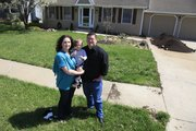 Laura Zell, son Henry and husband Devin are pictured in their front yard before turning it into a livable garden.