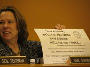 During a break in a meeting Wednesday of the Senate Ways and Means Committee, state Sen. Jean Schodorf, R-Wichita, displayed an anti-tax sign she pulled from her scrapbook that she found years ago when the Legislature had been considering a tax increase. The Ways and Means Committee recommended a state budget that requires $500 million in additional revenue and was considering various tax proposals.