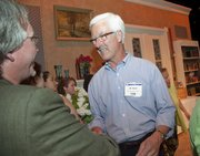 Dan Schamle, left, and Al Hack greet each other after the 25th annual Wallace Galluzzi Volunteer Awards on Wednesday. Hack received a Lifetime Service Award for his 15 years of work with the Boys and Girls Club. Schamle was honored for his longtime volunteer service with Headquarters Counseling Center.
