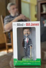 "The publishing company Doubleday, produced a Bill James bobble-head doll that coincided with James' book ""The Mind of Bill James."""
