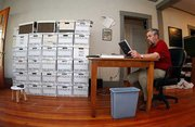 Bill James' home office is loaded with boxes of statistics, magazines, rosters and other documents that help him conduct his daily sports research.