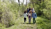A group of Langston Hughes students walks through the Baker Wetlands during a field trip supported by the Lied Center.