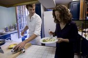 National Geographic chef Barton Seaver, left, offers sauteed lionfish to Renata Lana, a communications and outreach specialist from NOAA, Tuesday in the kitchen of Seaver's home in Washington, D.C.