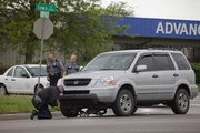 Lawrence police investigate an accident between an SUV and bicycle Friday, April 30 at 29th and Iowa Streets.