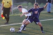 Free State's Regan Keasling (6) battles Olathe East's Kara Bartels (12) during the game Tuesday, May 4, 2010, at FSHS. Free State failed to score a goal in the 3-0 loss.
