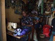 Auma Lucy, Awava's main tailor, in Gulu, Uganda.
