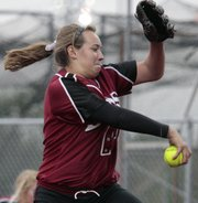 Lawrence High pitcher Lauren Massey fires another across the plate against Free State on Thursday at FSHS.