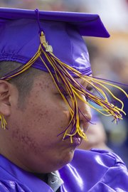 High winds kept tassels flying, as Jaken James experienced during the Haskell Indian Nations University 2010 graduation ceremony Friday.