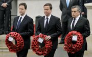 Britain's Prime Minister and leader of the Labour Party, Gordon Brown, right; Liberal Democrat party leader Nick Clegg, left; and Conservative Party leader David Cameron walk to lay wreaths during a remembrance service to mark VE Day on Saturday in London.