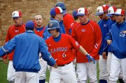 KU's Robby Price celebrates with teammates after his three-run homerun to right field tied the game against Missouri at six on Sunday, May 9, 2010.
