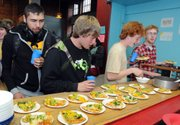 from left, Nick Widomski, Wyatt Kail, Jesse Kail and Matt Frye line up for pizza at the after-school supper program last month at the Brattleboro Boys & Girls Club in Brattleboro, Vt. The program, subsidized by the U.S. Department of Agriculture, provides nutritious meals to children in communities where more that half of households fall below the poverty level.