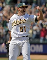 Oakland starting pitcher Dallas Braden celebrates throwing a perfect game against Tampa Bay on Sunday in Oakland, Calif.