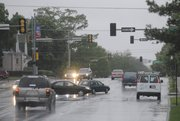 Drivers carefully proceed through the intersection of Ninth and Tennessee Streets, Monday, May 10, 2010 as traffic lights downtown were out because of a power outage. The power failures were confined primarily to the area north and east of 23rd and Iowa Streets.