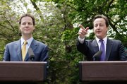 New British Prime Minister David Cameron, right, and Deputy Prime Minister Nick Clegg have their first joint press conference Wednesday in the garden of 10 Downing Street in London.